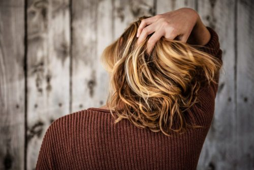 Woman Touching Her Thick Hair