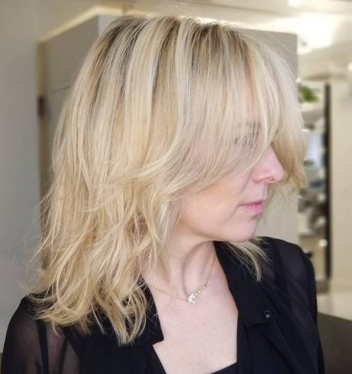 Over 40 Blonde Layers With Wispy Bangs