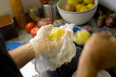 Straining Lemons Through Cheesecloth for the A-1 Pick-Me-Up Cocktail