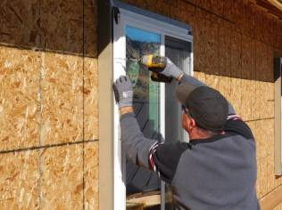 Alpen Certified Installer attaching window into ThermalBuck