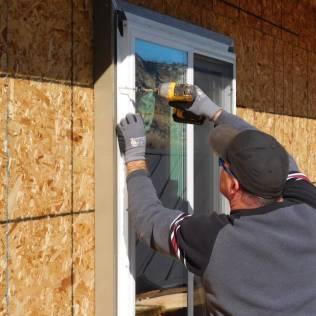 Alpen Certified Installer attaching window into ThermalBuck