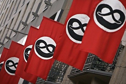 For the production of THE PRODUCERS in Berlin The Admiralspalast theater has been draped in giant red flags bedecked with black pretzels and sausages -- a satire on the swastika flag, illegal in postwar Germany.