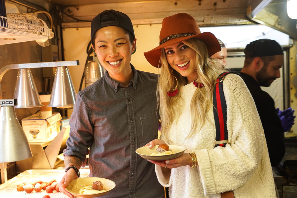 Lesley Murphy and Kristen Kish eating donuts in the Chase Sapphire Food Truck