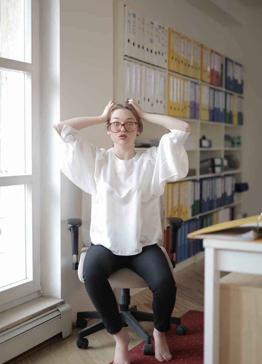 shocked female worker in modern workplace