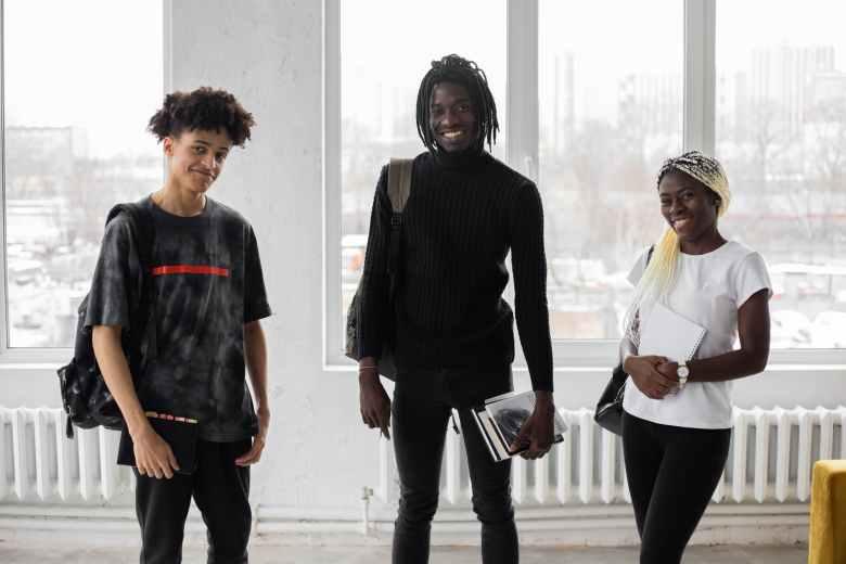 happy black students standing in classroom