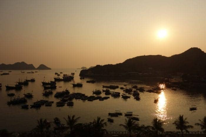 sunset, bay, Heading to Cat Ba island and doing amazing Ha Long bay on a backpacker budget, Ha Long Bay Vietnam, Ha Long bay cruise, Ha Long bay tours, Ha Long bay trip, Halong bay, Kayak, cheap, budget, from Hanoi, Ha Long bay without a tour, Money island, hike, monkeys, beach, swim, karst, mountain, Cat Ba Vietnam, Cat Ba Island, Cat ba hotel, Cat Ba island Vietnam