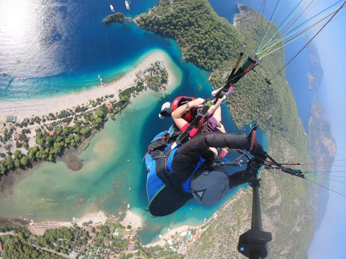 Paragliding in Oludeniz, Paragliding in Turkey, Oludeniz paragliding weight limit, best paragliding in the world, Paragliding in Fethiye over the blue lagoon beach in Hisaronu, Go Pro, Paragliding in Turkey safety, backpacking