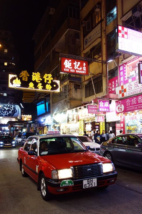 A famous Hong Kong taxi and neon signs in Chinese, Backpacking in Hong Kong for backpackers, Backpackers guide to Hong Kong, Hong Kong on a budget trip