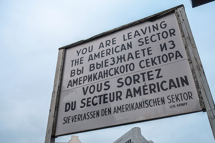 The multilingual sign in French, English, German and Russian at Checkpoint Charlie in Berlin. (2 days in Berlin, Things to do in Berlin, 2 days in Berlin itinerary, Berlin 2 days itinerary, Berlin in two days, 48 hours in Berlin itinerary, What to do in Berlin in 2 days, Berlin 2 days, Things to do in Berlin, backpacking Berlin, cheap, budget Berlin, Germany)