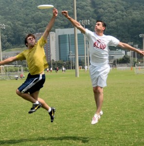 Ryan Colby (left) stretches to get his fingers on a tipped disc from Chris Hurt.