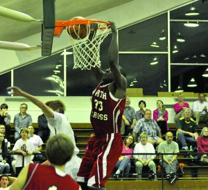 North Cross big-man Peter Agba throws down a slam dunk Saturday night on his way to a game-high 18 points.