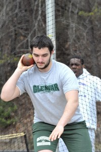Glenvar's Tristian Crockett sets the shot at his chin before his throw Saturday.