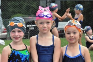 Read Mountain trio of (L-R) Josie Arthur, Maggie Hankins and Ava Ashworth sport some flashy swim caps amog the Muskies six-and-under swimmers.