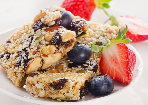Healthy fruit and nut granola bars on a plate.
