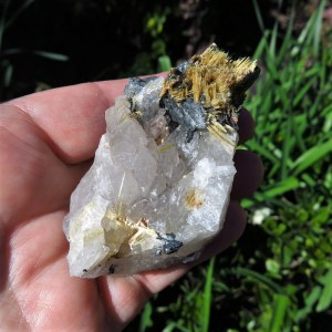 golden rutile needles on hematite and quartz cluster