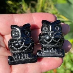crystal owls in black obsidian