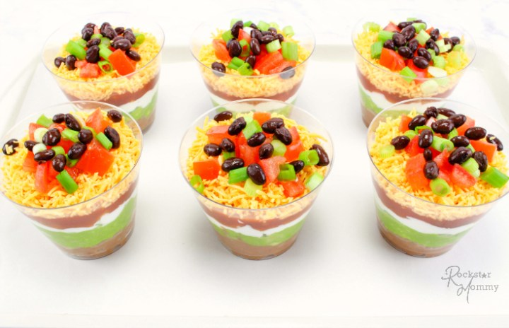 Mexican Bean Dip Cups - Appetizer cups on a plate