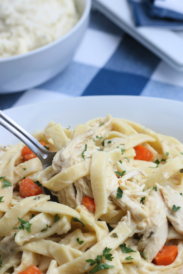 This Chicken and Noodles Recipe is loaded with egg noodles, tender chicken, and a creamy sauce, making it a hearty dish everyone loves!