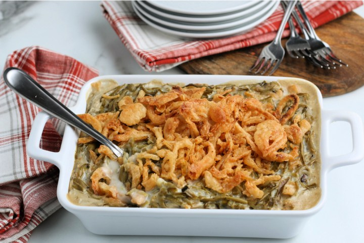 cooked easy green bean casserole in a white baking dish