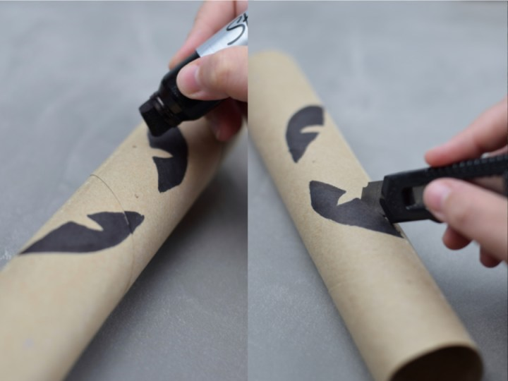 eyes being draw on a paper towel roll and cut out with a knife