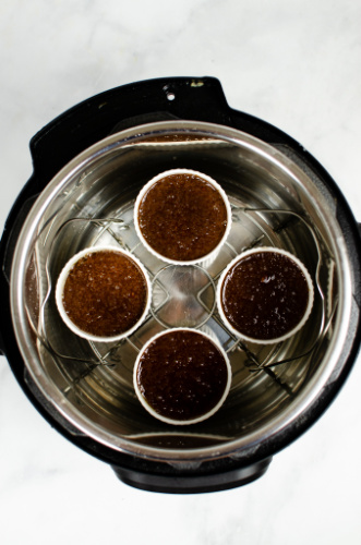 4 ramekins filled with chocolate cake batter in an instant pot