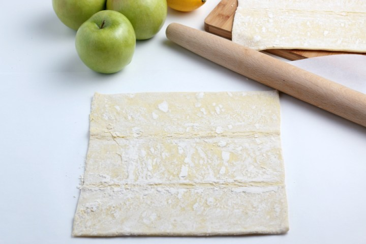 puff pastry laid out next to a rolling pin