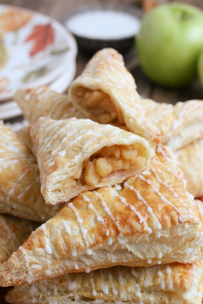 apple turnovers stacked on a plate