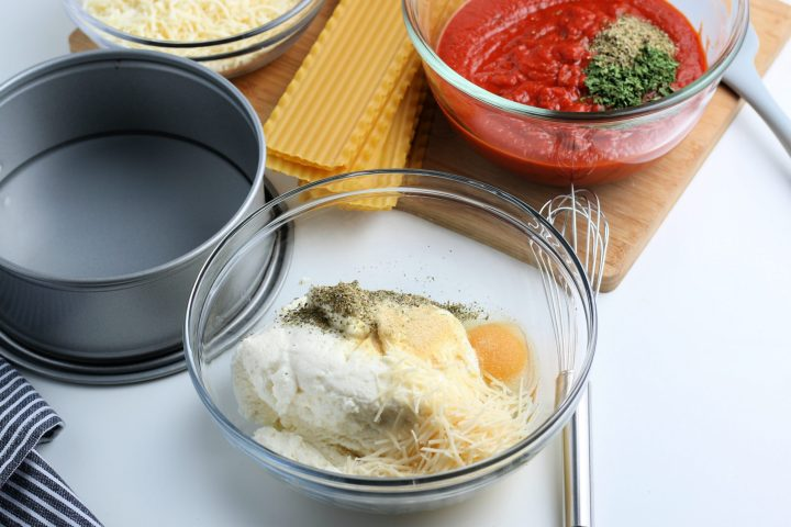 1 bowl with ricotta, cheese, egg, and seasoning. And another bowl with marinara sauce and seasonings