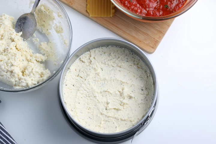 ricotta cheese mixture spread on top of noodles