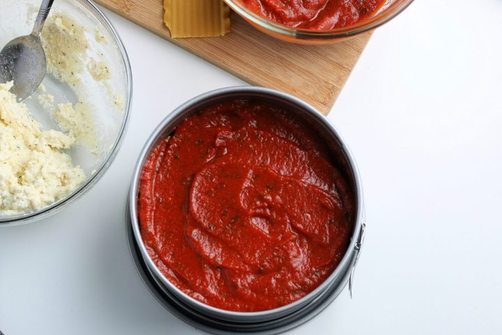 red sauce placed on top of meat mixture