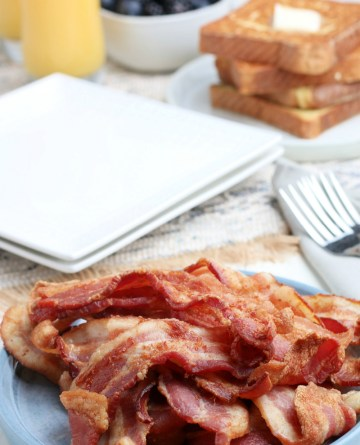 pile of cooked bacon a a plate