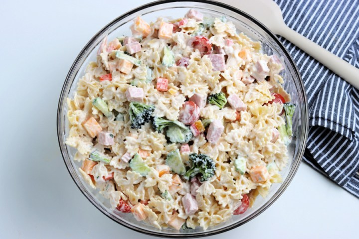 Summer Bowtie Pasta Salad in a large mixing bowl