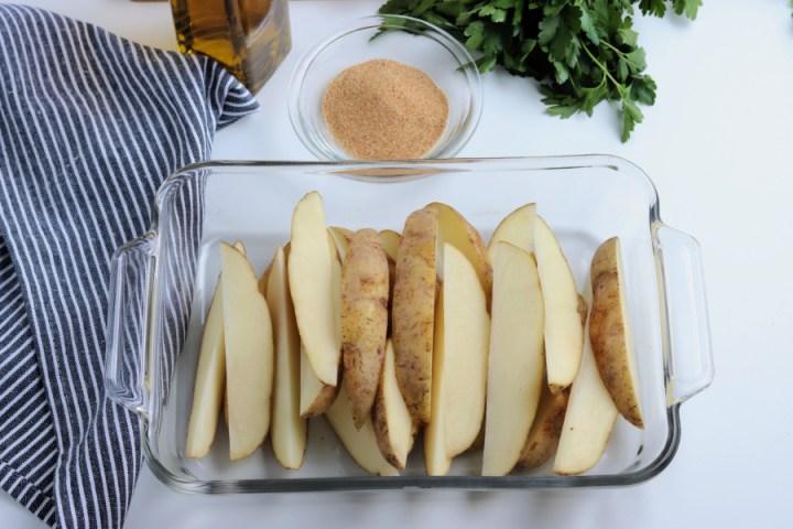 potato wedges in baking dish
