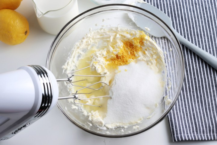 cream cheese, zest, lemon juice and sugar in a mixing bowl