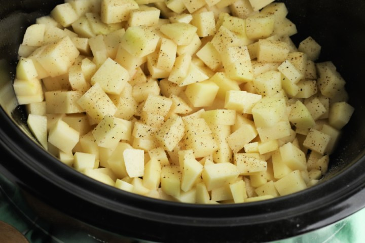 cubed potatoes and seasoning in slow cooker
