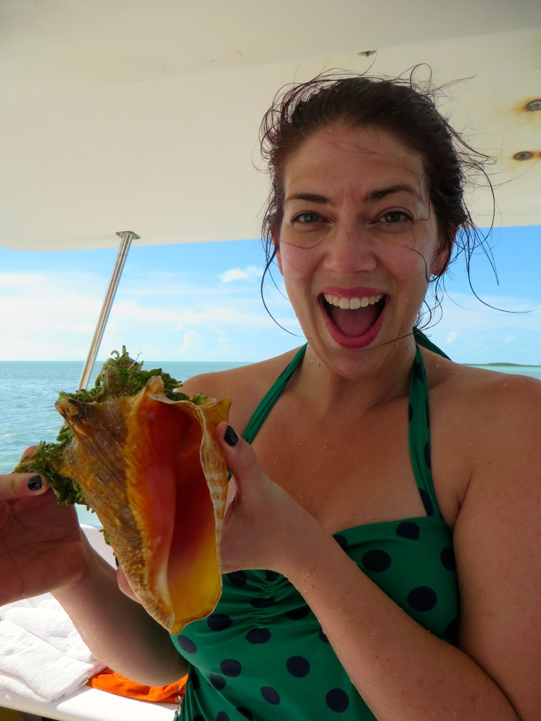 Sarah and her Conch on Caicos Dream Tours | The Rose Table