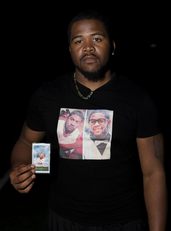 James Dinson wears a memorial shirt and  keeps a photograph of his brother Dejour Benson in his sock . Benson was fatally struck by a car in March of  last year, he passed away at the age of 17 - years old. Photo: Diego Barajas