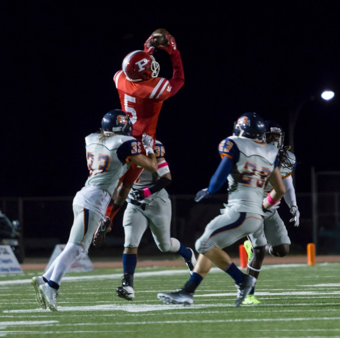 Number 5 Jamere goes up for the ball during the Brahmas game against Orange Coast College on Oct. 10, 2015 at John Shephard Staidum at Pierce College, Woodland Hills, Calif. The Brahmas would lose 35-7 against the Pirates. Photo by: Gustavo Sanchez