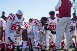Pierce College's football team takes knee after being defeated by Valley College, Pierce College lost the Football game 39 -7, at Los Angeles Valley College on Oct. 30, 2015 in Valley Glen, area of Los Angeles Calif. (Photo by: Edgar Amezcua)