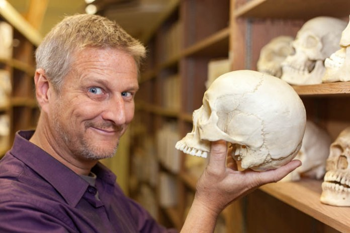 """Before earning his doctorate in physical anthropology from Tulane University in New Orleans, Assistant Professor of Anthropology Brian Pierson worked in Hollywood for a decade as a special effects artist on films such as Zack Snyder's 2006 adaptation of """"300."""" While working on his doctorate at Tulane, he was tasked by local law enforcement to produce a forensic facial reproduction to help solve a murder case. Pierson, who was hired to work at Pierce full-time in 2013 has a new forensics class, Anthropology 119–Introduction to Forensic Anthropology, that was added to the schedule spring 2016. In this class, he teaches students how the analysis of bones is used to help solve criminal cases. Photo by Calvin B. Alagot / Roundup"""
