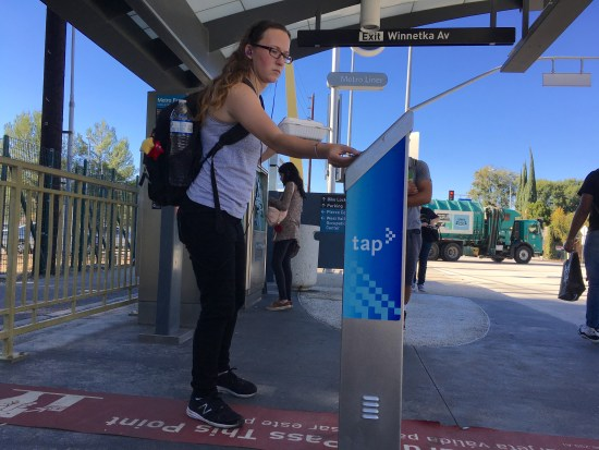 Pierce student, Alec Bick, 20, uses her student monthly tap card at the Winnetka Orange Line station in Woodland Hills, Calif. on Tuesday, Nov. 8. Students are required to have a class schedule of 12 units to get a reduced student card. President of ASO Barbara Lombrano, is pushing to lower the requirements to 6 units. Photo by Mohammad Djauhari