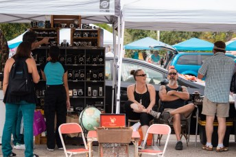 Christine Moradians (right) and Jesse Moradians (left) sit and laugh with community members at the Vintage Market at Pierce College in Woodland Hills, Calif., on Sept. 22, 2019. Photo by Katya Castillo.