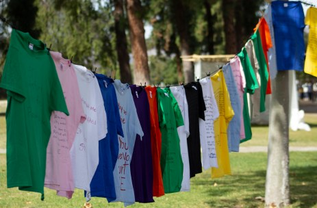 Shirts hang during the Clothesline Project on Oct. 16, 2019 in Rocky Young Park at Pierce College in Woodland Hills, Calif. Hosted by ASO, the Diversity Committee and B.R.A.V.E., this event brings awareness to survivors of abuse by displaying messages or stories written by students. Photo by Angelica Lopez.