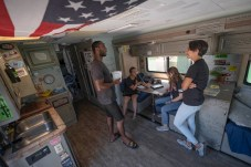 (Left to right) Roadtrip Nation Ambassadors John Broadway and Alli Brinkerhoff converse with visitors, Rebecca Solomon and Lauren Franco of Career and Transfer Center of LA Pierce College, at a tiny living room and kitchen inside the Roadtrip Nation RV, Oct. 3, 2019, in Woodland Hills, Calif. Photo by Kevin Lendio.