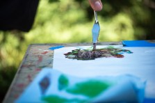 Alex Flack, Art 309 student, carefully mixes his paints on the Art Hill in Woodland Hills, Calif., on Oct. 24, 2019. Photo by Sophia Gomez.
