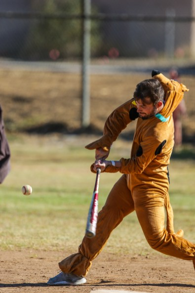 Jackson Briscoe dressed as Scooby Doo hits a pitch during Pierce College Baseball's Halloween Backwards Game at Joe Kelly Field in Woodland Hills, Calif. on Oct. 31, 2019. Photo by Benjamin Hanson.