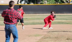 (Right) Alex Owens looks to third base during a split-squad Halloween game at Pierce College's Kelly Field on Oct. 31, 2019. Photo by Cecilia Parada.