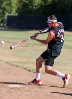 Tyler Freeland swings at the ball during a split-squad Halloween game at Pierce College's Kelly Field on Oct. 31, 2019. Photo by Cecilia Parada.