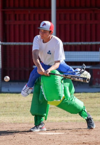 Sam Brand swings at the ball during a split-squad Halloween game at Pierce College's Kelly Field on Oct. 31, 2019. Photo by Cecilia Parada.