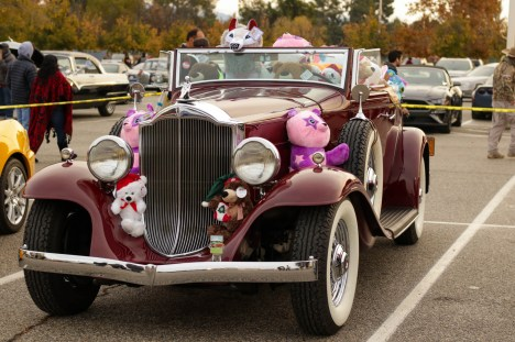 A classic car covered with stuffed animals at Motor 4 Toys at Pierce College's Parking Lot 7 in Woodland Hills, Calif. on Dec. 1, 2019.
